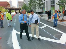 Gabe and Emanuel inspect the new bike lane