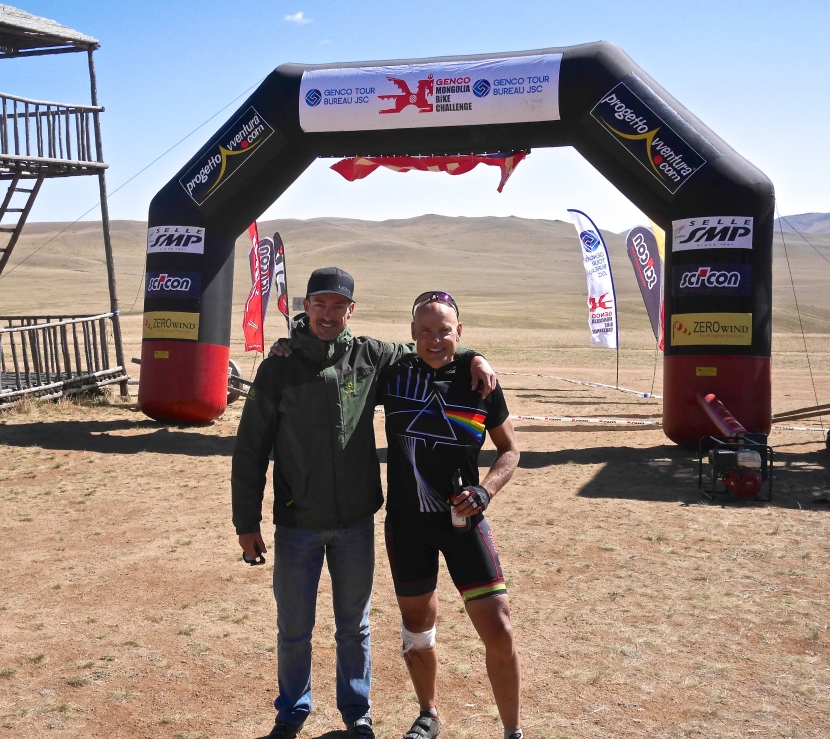 Chris & I on the finish line after the filan stage of the 2014 Mongolia Bike Challenge