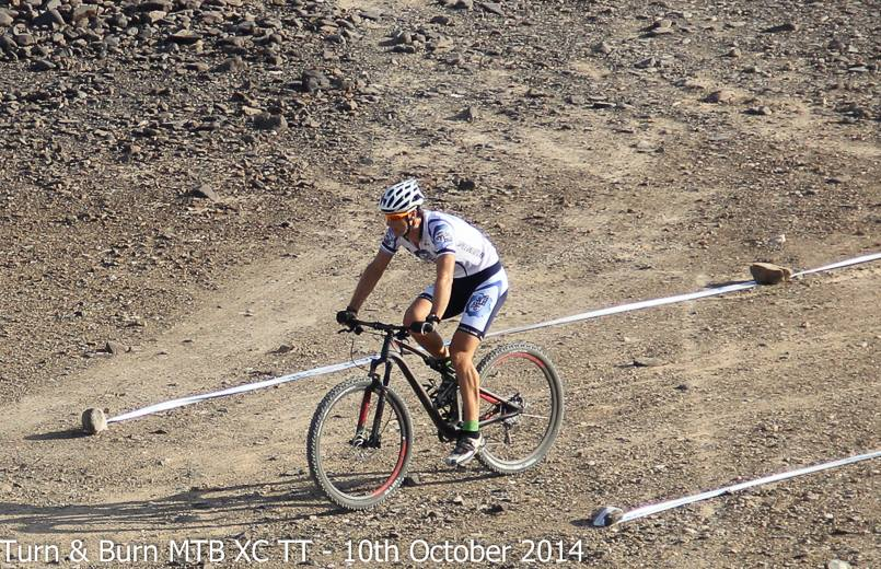 Tom Little cracking the course at the Turn & Burn MTB XC TT